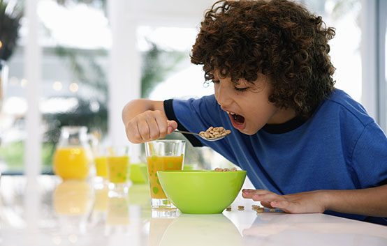 Boy Eating Cereal Breakfast