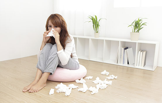 Woman Sick Blowing Nose